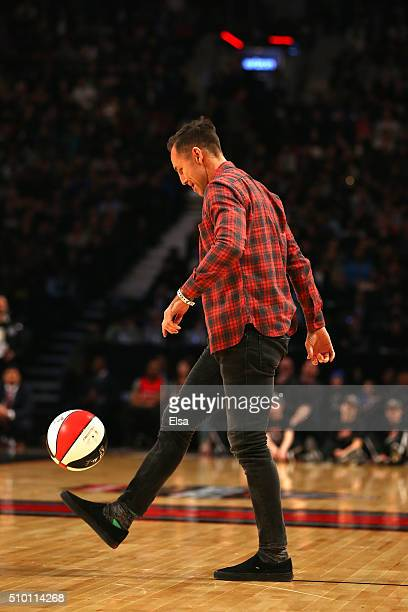 Former NBA player Steve Nash prepares to help with a dunk in the Verizon Slam Dunk Contest during NBA AllStar Weekend 2016 at Air Canada Centre on...