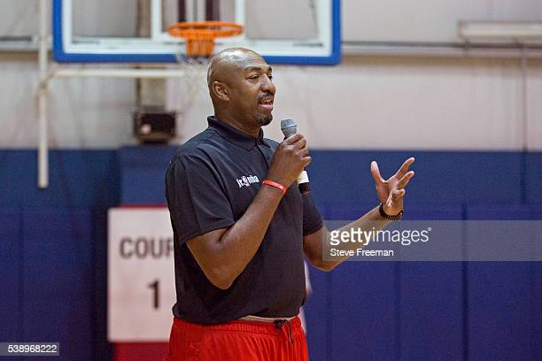 Former NBA player Vin Baker talks to kids during the Jr NBA skills competition regional finals held at Chelsea Piers in Stamford Connecticut on June...