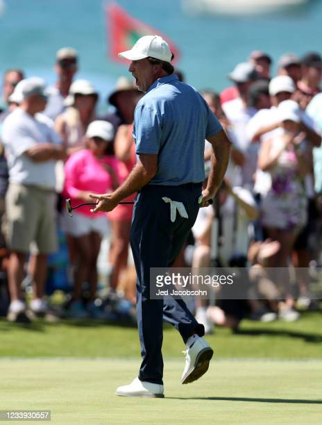 Former NBA player Vinny Del Negro celebrates after winning the final round of the American Century Championship at Edgewood Tahoe South golf course...