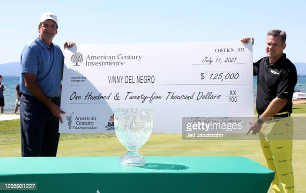 Former NBA player Vinny Del Negro celebrates with a check after winning the final round of the American Century Championship at Edgewood Tahoe South...