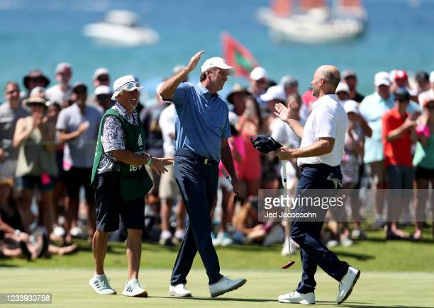 Former NBA player Vinny Del Negro, left, celebrates with former MLB athlete John Smoltz after winning the final round of the American Century...