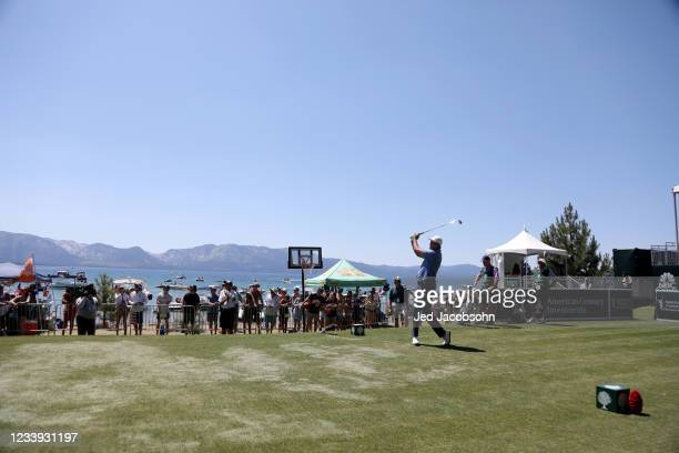 Former NBA player Vinny Del Negro tees off on the 17th hole during the final round of the American Century Championship at Edgewood Tahoe South golf...
