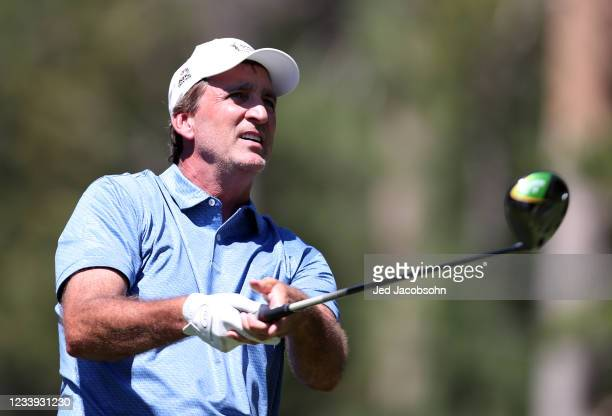 Former NBA player Vinny Del Negro tees off on the 18th hole during the final round of the American Century Championship at Edgewood Tahoe South golf...
