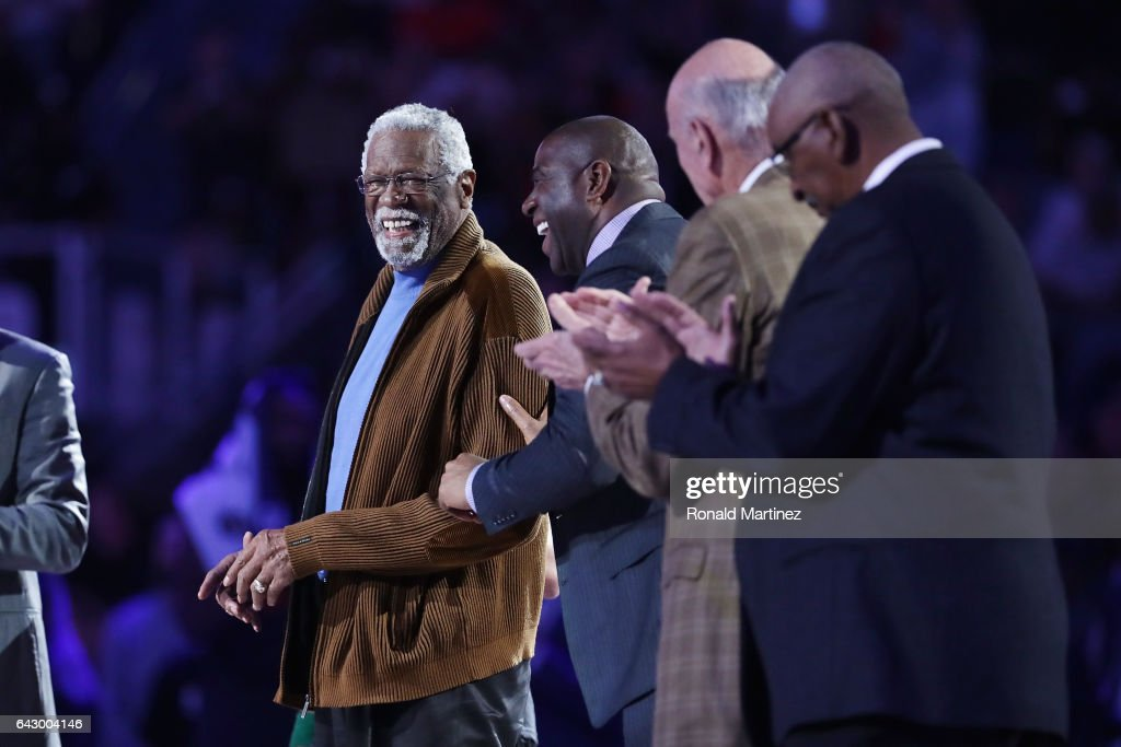 Former NBA players Bill Russell (L) and Earvin 'Magic' Johnson Jr. react as they are honored during the 2017 NBA All-Star Game at Smoothie King Center on February 19, 2017 in New Orleans, Louisiana.