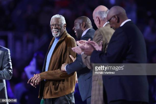 Former NBA players Bill Russell and Earvin 'Magic' Johnson Jr react as they are honored during the 2017 NBA AllStar Game at Smoothie King Center on...
