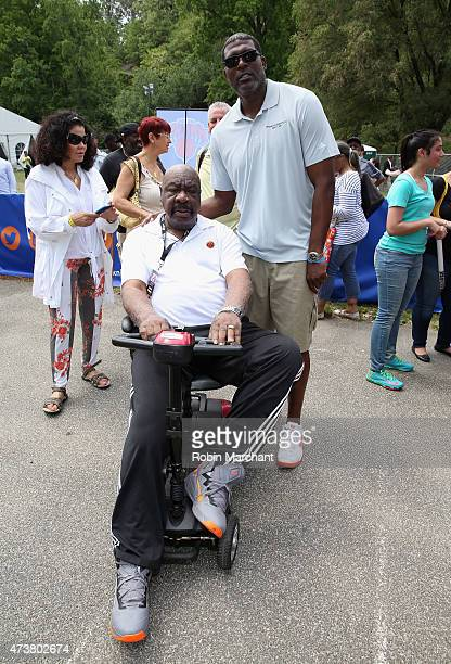 Former NBA Players Cal Ramsey and Larry Johnson attend A Sunday Afternoon In Harlem Presented By Aetna during the Harlem EatUp Festival on May 17...
