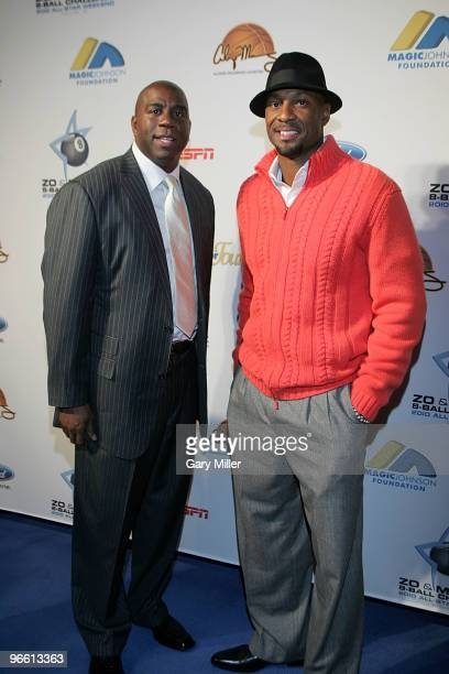 Former NBA players Earvin 'Magic' Johnson and Alonzo Mourning arrive at 'Zo and Magic's 8Ball Challenge' at Centennial Hall at Fair Park on February...