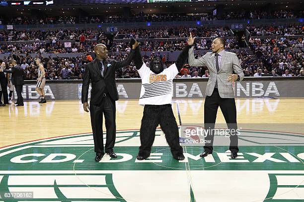 Former NBA players Gary Payton and Shawn Marion wave to crowd during the San Antonio Spurs game against the Phoenix Suns as part of NBA Global Games...