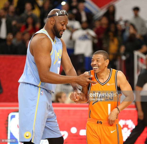 Former NBA players Muggsy Bogues and Horace Grant greet each other during the 2018 NBA Cares Unified Basketball Game as part of 2018 NBA AllStar...