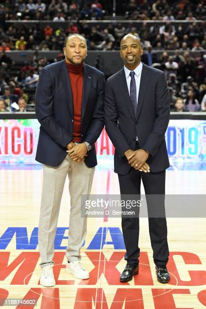 Former NBA players Shawn Marion and Richard Hamilton pose for a photo during halftime of the game between the Dallas Mavericks and the Detroit...