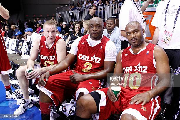 Former NBA players Tim Hardaway Mitch Richmond and Chris Mullin pose for a photo during the Sprint AllStar Celebrity Game on center court at Jam...