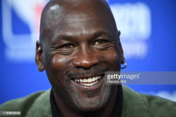 Former NBA star and owner of Charlotte Hornets team Michael Jordan looks on as he addresses a press conference ahead of the NBA basketball match...