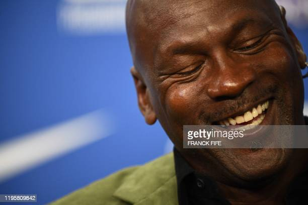 Former NBA star and owner of Charlotte Hornets team Michael Jordan gestures as he addresses a press conference ahead of the NBA basketball match...