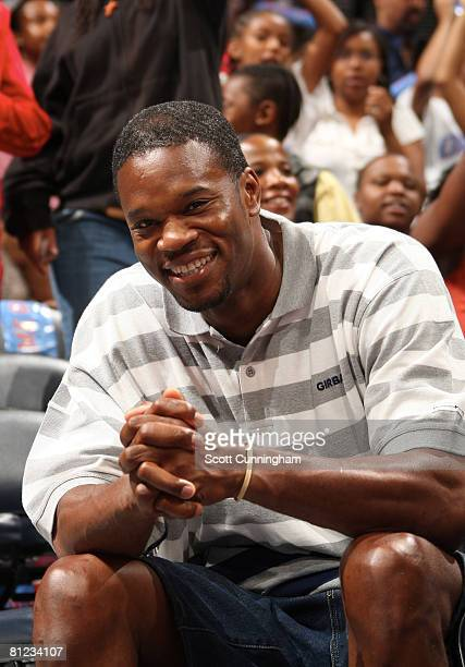 Former NBA star Antonio Davis enjoys the game between the Atlanta Dream and the Los Angeles Sparks at Philips Arena on May 25 2008 in Atlanta Georgia...