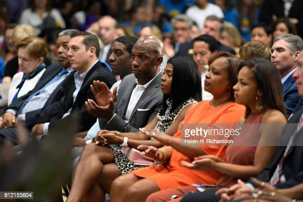 Former NBA star Chauncey Billups fourth from right sits with his wife Piper third from right as they listen to Denver Mayor Michael Hancock give his...