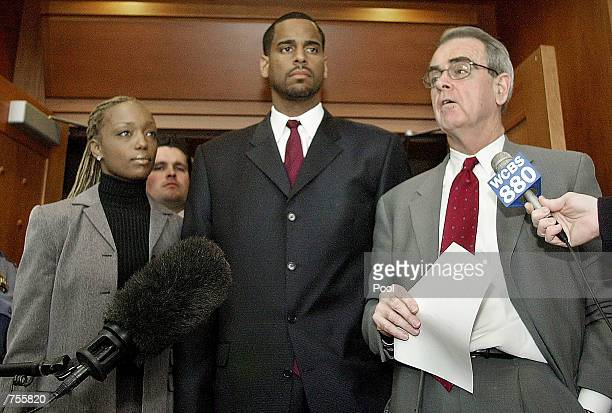 Former NBA star Jayson Williams his wife Tanya listen as attorney Joseph Hayden speaks to the news media March 4 2002 after a hearing at the...