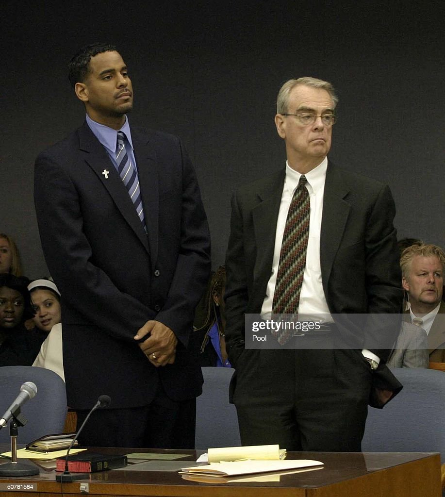 Former NBA star Jayson Williams (L) stands with one of his defense attorneys Joseph Hayden as the jurors walk into the courtroom at the beginning of the second day of jury deliberations during Williams' manslaughter trial at the Somerset County Courthouse April 28, 2004 in Somerville, New Jersey. Williams is accused of manslaughter in the shotgun death of hired driver Costas Christofi at Williams' estate in Alexandria Township, New Jersey February 14, 2002.