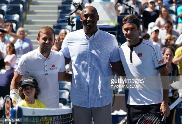Former NBA star Kobe Bryant Roger Federer of Switzerland and Daniel Evans of Great Britain pose before their Round Three Men's Singles match at the...