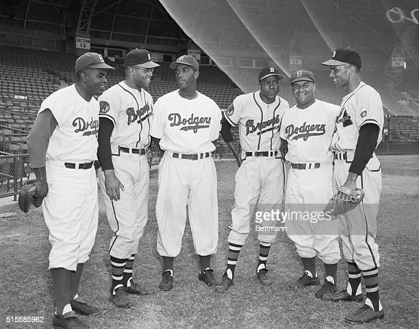 Former Negro League and current National League players stand together before a spring training game between the Brooklyn Dodgers and Boston Braves...