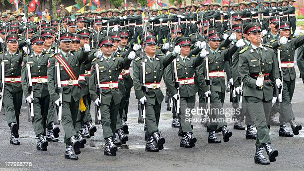 Former Nepalese Maoist fighters march during a passing out ceremony at The Nepalese Military Academy in Bhaktapur on the outskirts of Kathmandu on...