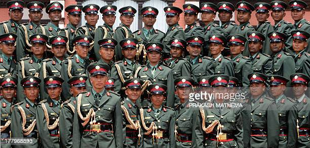 Former Nepalese Maoist fighters pose for a photograph after a passing out ceremony at The Nepalese Military Academy in Bhaktapur on the outskirts of...