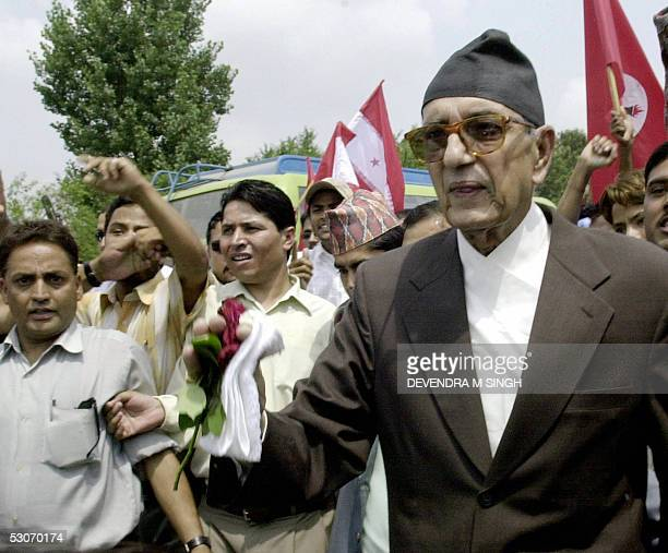 Former Nepalese Prime Minister and President of the opposition Nepali Congress party Girija Prasad Koirala is welcomed by supporters upon his return...