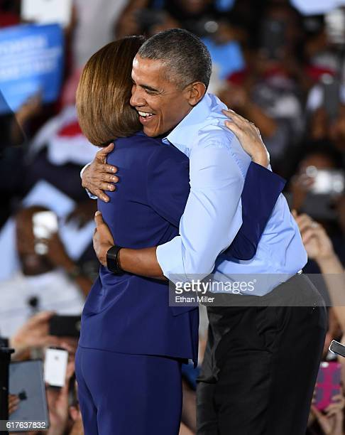Former Nevada Attorney General and Democratic US Senate candidate Catherine Cortez Masto greets US President Barack Obama at a campaign rally for...