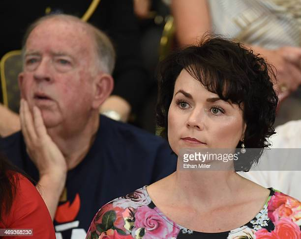 Former Nevada Republican Party Chairwoman Amy Tarkanian listens as Republican presidential candidate US Sen Rand Paul speaks during a rally at the...