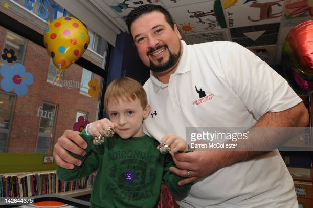 Former New England Patriot Joe Andruzzi greets spring with Ryan at Children's Hospital Boston on April 10 2012 in Boston Massachusetts