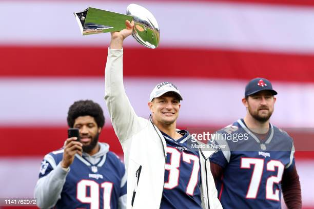Former New England Patriots player Rob Gronkowski raises the Lombardi Trophy over his head before the Red Sox home opening game against the Toronto...