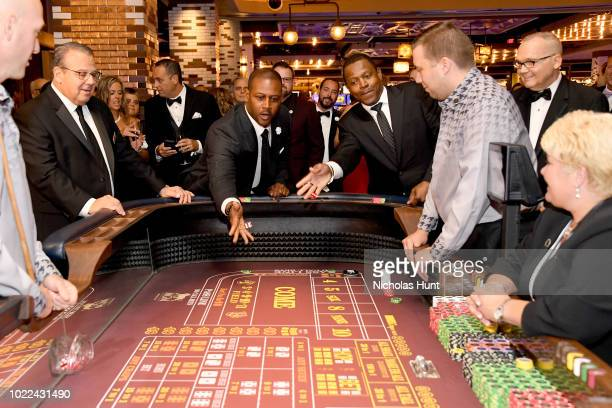 Former New England Patriots players Ty Law and Troy Brown attend the Grand Opening Celebration for MGM Springfield on August 23, 2018 in Springfield,...