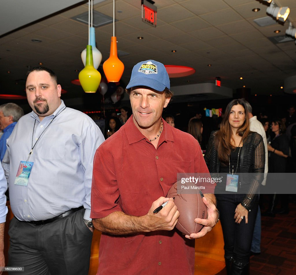 Former New England Patriots Quarterback Doug Flutie (C) attends the10th Annual Flutie Bowl to strike out autism at KINGS on January 28, 2013 in Boston, Massachusetts.