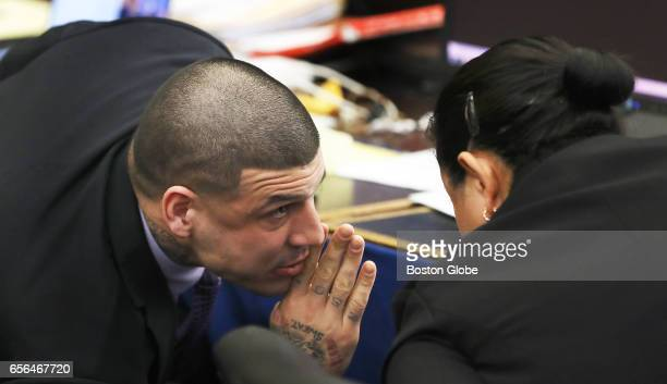 Former New England Patriots tight end Aaron Hernandez speaks to defense attorney Michelle Medina during a sidebar His double murder trial continues...