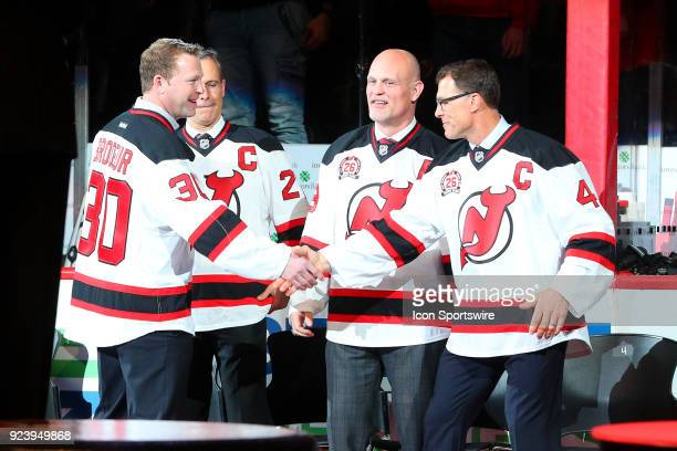 Former New Jersey Devil Martin Brodeur and Scott Niedermayer shaker hands during Patrik Elias Jersey Retirement Night prior to the National Hockey...