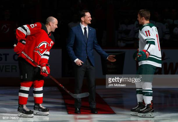 Former New Jersey Devil Patrik Elias has a laugh before dropping the ceremonial first puck between Andy Greene and Zach Parise of the Minnesota Wild...