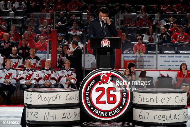 Former New Jersey Devil Patrik Elias wipes away tears during his jersey retirement ceremony prior to a game against the New York Islanders at the...