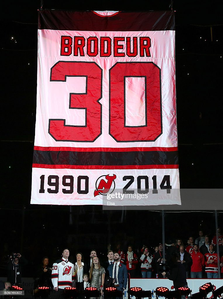 Former New Jersey Devils goaltender Martin Brodeur and his family watch as his banner is lifted during his jersey retirement ceremony before the game between the New Jersey Devils and the Edmonton Oilers on 9, 2016 at Prudential Center in Newark, New Jersey.