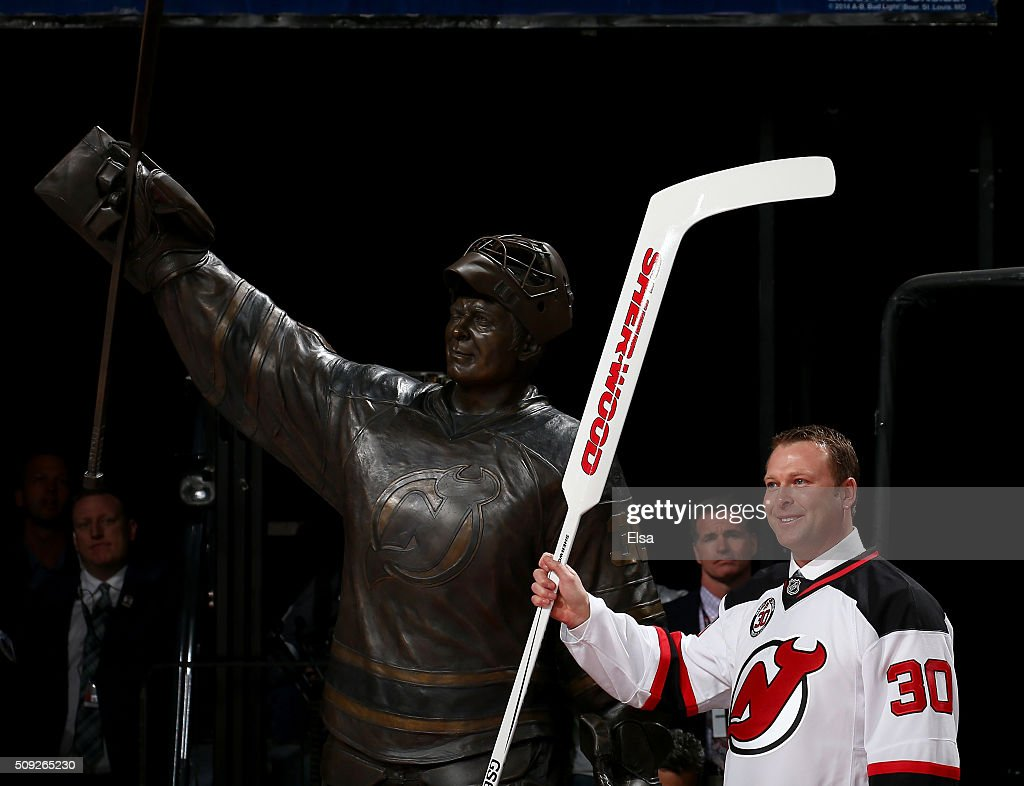Former New Jersey Devils goaltender Martin Brodeur poses next to his statue during his jersey retirement ceremony before the game between the New Jersey Devils and the Edmonton Oilers on 9, 2016 at Prudential Center in Newark, New Jersey.