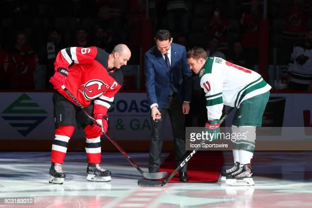 Former New Jersey Devils Patrik Elias drops a Ceremonial puck between New Jersey Devils defenseman Andy Greene and Minnesota Wild left wing Zach...