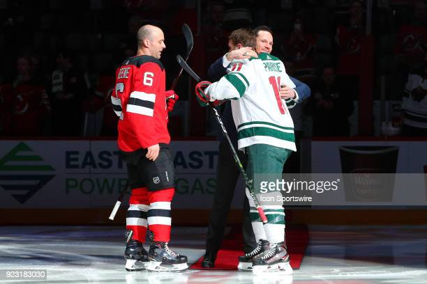 Former New Jersey Devils Patrik Elias hugs Minnesota Wild left wing Zach Parise after the Ceremonial puck drop prior to the first period of the...