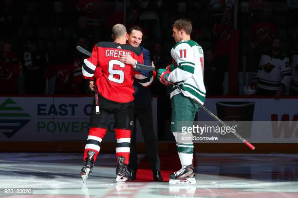 Former New Jersey Devils Patrik Elias hugs New Jersey Devils defenseman Andy Greene after the Ceremonial puck drop prior to the first period of the...