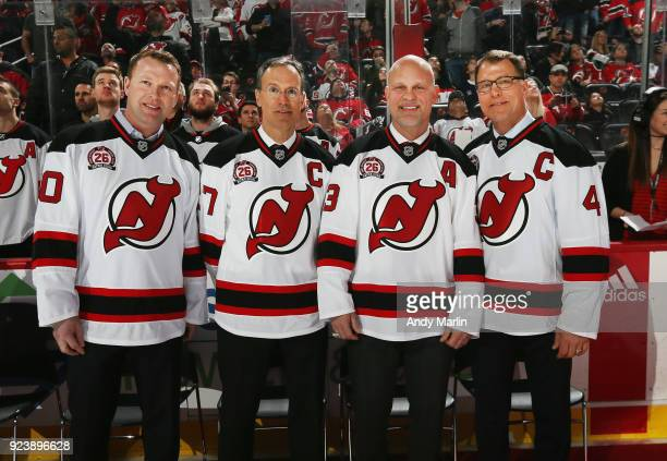 Former New Jersey Devils players Martin Brodeur Scott Niedermayer Ken Daneyko and Scott Stevens pose for a photo during the ceremony to retire Patrik...