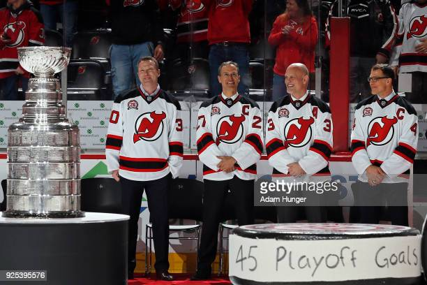 Former New Jersey Devils players Martin Brodeur Scott Niedermayer Ken Daneyko and Scott Stevens during Patrik Elias jersey retirement ceremony prior...