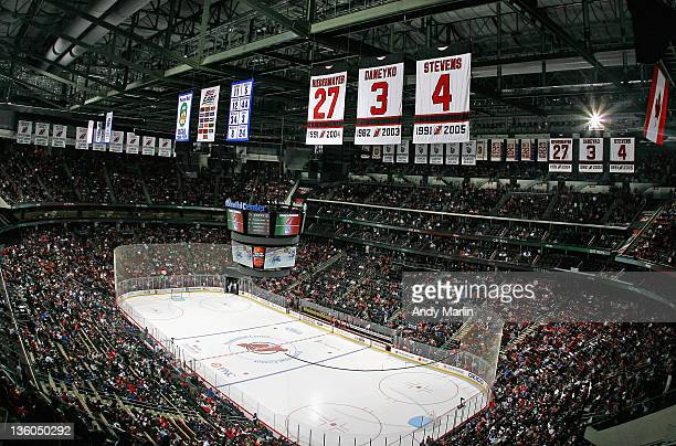 Former New Jersey Devils Scott Niedermayer's retired jersey hangs from the rafters next to Ken Daneyko's and Scott Stevens during the game against...
