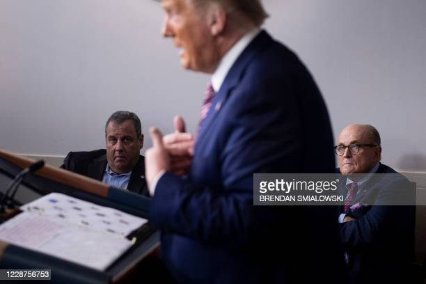 Former New Jersey Governor Chris Christie and Former New York City Mayor Rudy Giuliani listen while US President Donald Trump speaks during a...