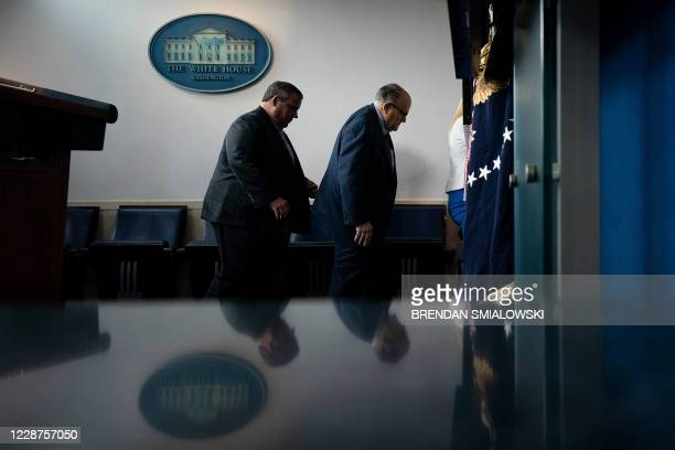 Former New Jersey Governor Chris Christie and former New York City Mayor Rudy Giuliani leave after a briefing at the White House September 27 in...