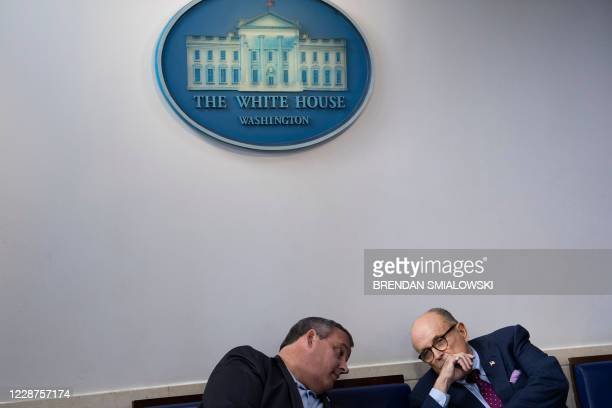 Former New Jersey Governor Chris Christie and former New York City Mayor Rudy Giuliani speak before a briefing at the White House September 27 in...