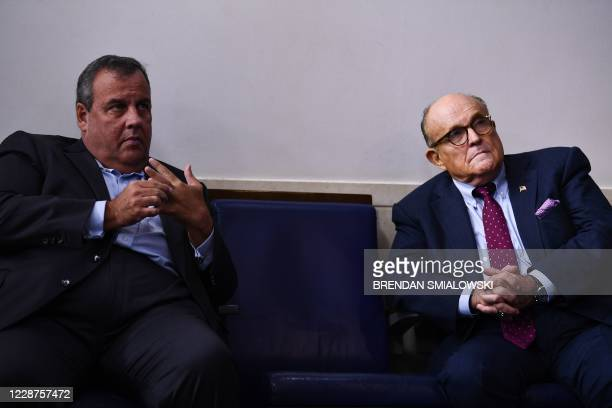 Former New Jersey Governor Chris Christie and former New York City Mayor Rudy Giuliani talk before a briefing at the White House September 27 in...