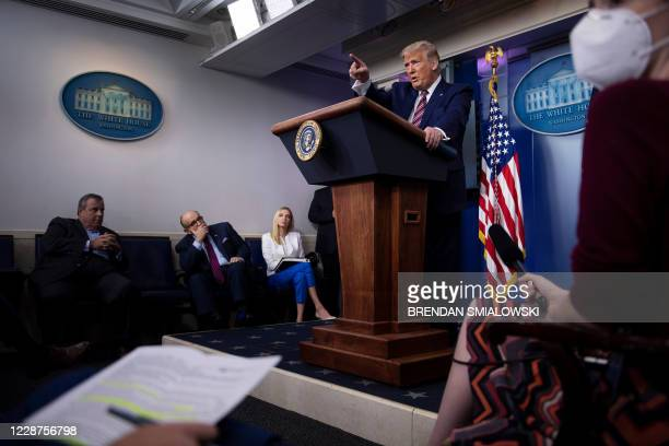 Former New Jersey Governor Chris Christie, former New York City Mayor Rudy Giuliani, White House Press Secretary Kayleigh McEnany, and others listen...