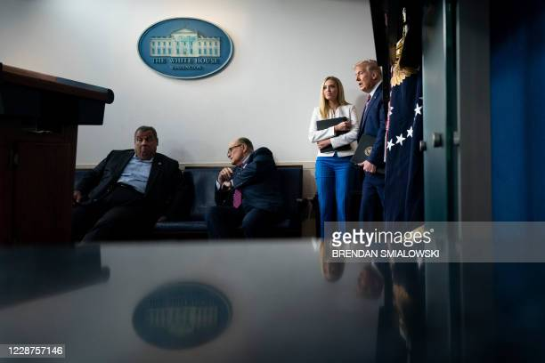 Former New Jersey Governor Chris Christie, former New York City Mayor Rudy Giuliani, and White House Press Secretary Kayleigh McEnany, wait while US...